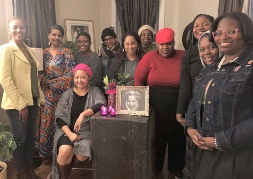 ODE TO AN ICON: Hostess Keli Stewart, seated, at a Toni Morrison birthday party her organization sponsored. The event featured women reading quotations from the famous author's various novels and essays. | BONNIE McKEOWN/Contributor