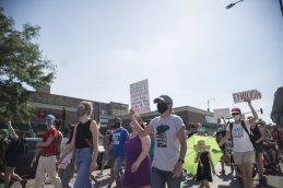 Demonstrators march on Saturday, July 25, 2020, during the Love March along Cocoran Street in Chicago's Austin neighborhood. | ALEX ROGALS/Staff Photographer