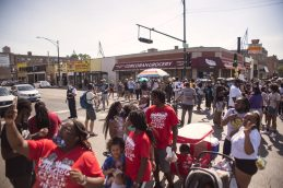 Marchers prepare to move on Saturday, July 25, 2020, during the Love March along Cocoran Street in Chicago's Austin neighborhood. | ALEX ROGALS/Staff Photographer