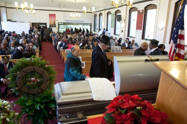 Saying goodbye: Mourners file past the casket of the Rev. Lewis Flowers, whose funeral was Saturday at Pleasant Ridge Missionary Baptist Church in Chicago.