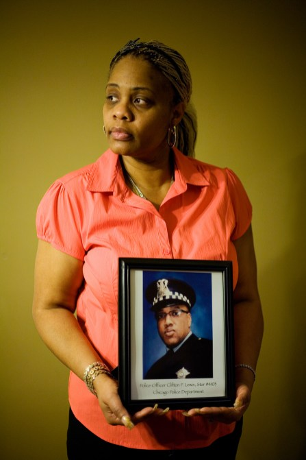 """'Live your life': Latrice Tucker with a photo of her fiance, Chicago police Officer Clifton Lewis, who was fatally shot in December 2011. """"I am just the luckiest person alive to have had him in my life,"""" Tucker says.DAVID PIERINI/Staff photographer"""