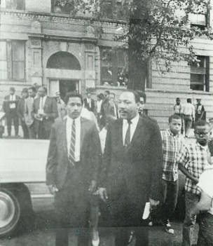 Then and now: Dr. King exits the building at 1550 S. Hamlin where his family stayed in 1966.File photo