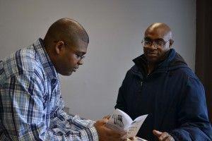 Vet-to-vet: Bizzle talking with fellow veteran Arthur Doss.