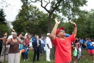 """William Brown was moved as he listened to the song, """"Greater Is Coming"""" as sung by Jasmine Barnes during National Night Out festivities in Moore Park Tuesday. Music, speakers and free school uniforms were among the highlights. (David Pierini/staff photographer)"""