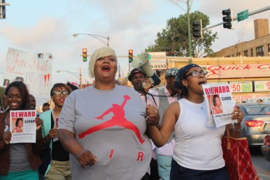 Ashake Banks, mother of Heaven Sutton, walks with Tiffany Hardman, mother of Ashley Hardman, 19, who was shot in July, at last Wednesday's peace march.Photos by DAISY WINFREY/Contributor