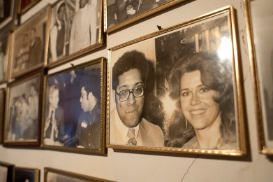 A wall in David Schultz's home chronicles his long career as a film critic with pictures that show him at interviews with some of Hollywood's biggest stars. (David Pierini/staff photographer)