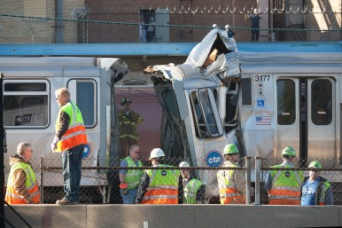 CTA and fire officials investigate a train collision that happened near the Blue Line platform at Harlem in Forest Park Monday. (David Pierin/staff photographer)