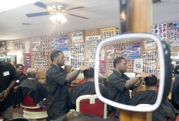 Nasee Yehuda cuts a customers hair. Students must complete 1,500 hours of course work, including 600 of practical work in the shop. (David Pierini/staff photographer)
