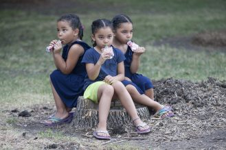 Triplets Rose, Kiara and Carmen Sims enjoy the festivities at National Night Out Aug. 6, at Moore Park. (DAVID PIERINI/Staff Photographer)