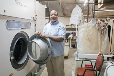 Clean sweep: James Forrest presses choir robes at Forrest Cleaners, a business on West Chicago Avenue, started by his father in 1963. It was the first black owned dry cleaners on the city's West Side.(DAVID PIERINI/Staff Photographer)