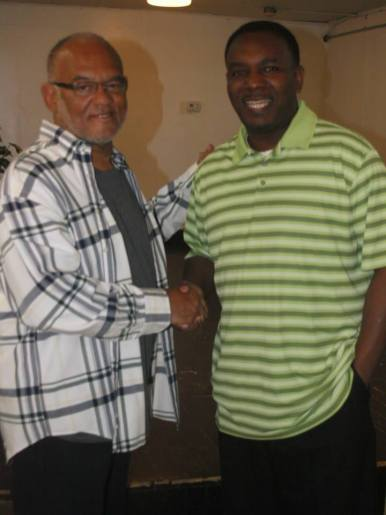 Mr. Alexander, owner of MacArthur's Restaurant, with Pastor Acree.