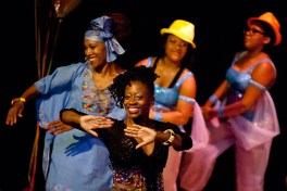 "A line of dancers, including Grenita Hall, dances to ""Happy."" (David Pierini/staff photographer)"