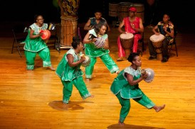 The Sankofa Dancers play shekeres, a musical instrument made from a gourd. (David Pierini/staff photographer)