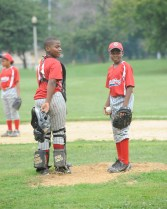 Number 4 Jaylen Harris pitches. Number 14 Malik Seaton plays as catcher. The West Garfield Park Little League hosted the game against Bloomington little leaguers. Despite a national decline in inner cities, baseball has found its way into the hearts of Austinites. (Jennifer Wolfe/Contributor)