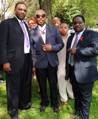 Rev. Ira Acree, Rev. Marshall Hatch and MC Hammer at the graveyard of Michael Brown's burial on Aug. 25, 2014.