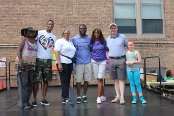 Posing in this photo (left to right) are Commissioner Barbara McGowan, Metropolitan Water Reclamation District of Greater Chicago; NBA Boston Celtics' Star Evan Turner; Aldermen Jason C. Ervin (28th Ward) and Deborah Graham (29th Ward); Rep. Camille Y. Lilly (78th District) and Sen. Don Harmon (39th District) and his daughter, Maggie.