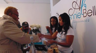 Austin resident Shelia Mingo purchased bath salt and alkaline water at Annie Bell Fragrances Oct. 4, during the Black Economic Empowerment Rally (BEER) for the new Austin shop.