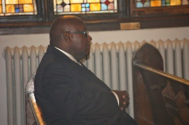 A watchful eye: Pastor Haman Gibson watches his church's Oct. 12, Women's Day service from the back pew. (MICHAEL ROMAIN/Contributor)