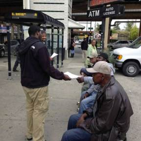 Listen up: Tevin Smith passes out flyers to men at Lake and Laramie. (Michael Romain/Contributor)