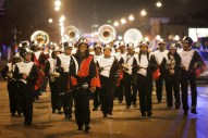 The Proviso West High School Marching Band performs in a parade down Madison Street during the Austin Chamber of Commerce's 10th Annual Tree Lighting and Holiday Party on Thursday, December 4, 2014. | Chandler West/Staff Photographer
