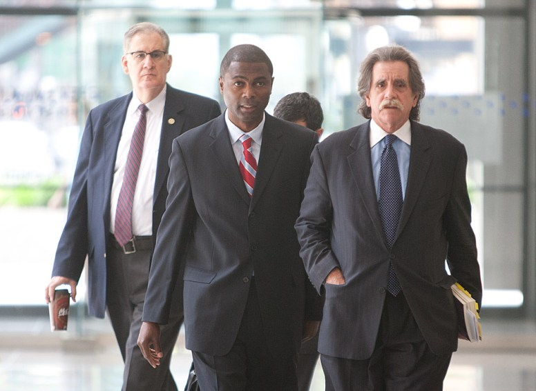 State Rep. LaShawn Ford, center, walks out of federal court in Chicago with his attorney, Tom Durkin, right, Aug. 4, after Ford pleaded guilty to a misdemeanor charge of filing a false tax return. The Feds ended up dropping the 17 bank fraud felony charges against Ford. (David Pierini/staff photographer)