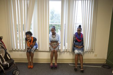 "Models Belinda Williams, Dee Jones and Lauren Whetstone wait for the start of the ""Natural Hair and Fashion Show"" Aug. 23, at Sankofa Cultural Arts Center. (David Pierini/staff photographer)"