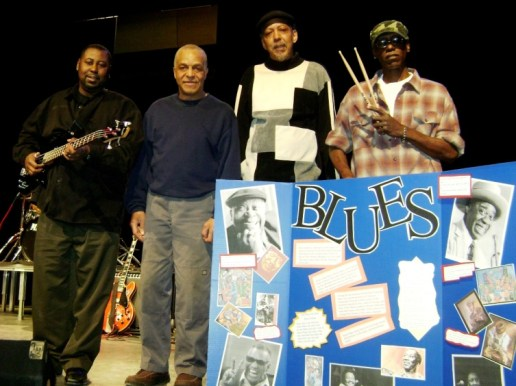 Two pairs of talented West Side blues brothers play at Antioch, IL high school in 2009: Eddie Taylor Jr., guitar, Vernon Harrington guitar; Joe Harrington bass, Larry Taylor drums.