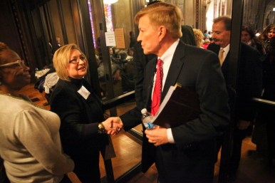Women: Ald. Bob Fioretti, 2nd Ward, shakes hands on his way out of the Chicago Women Take Action Alliance Mayoral Forum on Jan. 24. (Chandler West/Staff Photographer)
