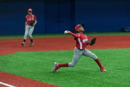 Jaylen Harris 11, of the Garfield Park little league team throws a ball to first base during practice at the newly indoor baseball field located at UIC. (William Camargo/Contributor)