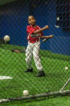 Tristan Phipps 10, of the little league team of Garfield Park practices his swing at an indoor baseball field located at UIC on February 14. (William Camargo/Contributor)