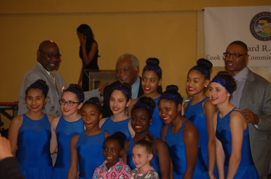 Metropolitan Water Reclamation District Vice President Barbara McGowan, Congressman Danny K. Davis and 1st District Cook County Commissioner Richard Boykin pose with dancers from Maywood Fine Arts at Boykin's Feb. 19 Black History dinner and awards program. (Michael Romain/Staff)
