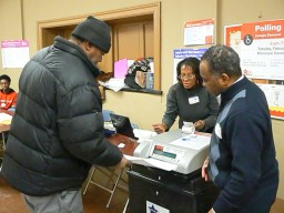An election worker assists voters at a polling place at Lafollette Park, 1333 N. Laramie Avenue. La Risa Lynch/Contributing Reporter.