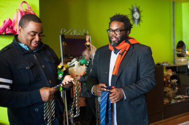 """Marseil """"Action"""" Jackson and Brandon Johnson look at ties at Second Times the Charm Boutique on Saturday, during a Black Economic Empowerment Rally (B.E.E.R). (Max Herman/Contributor)"""