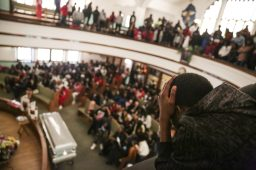Mourning: Funeral services for Andre Chatman, 23, at New Deliverance Church of God last Saturday. Chatman was one of the two men who was recently gunned down in broad daylight near North Avenue in Austin. (Chandler West/Staff Photographer)