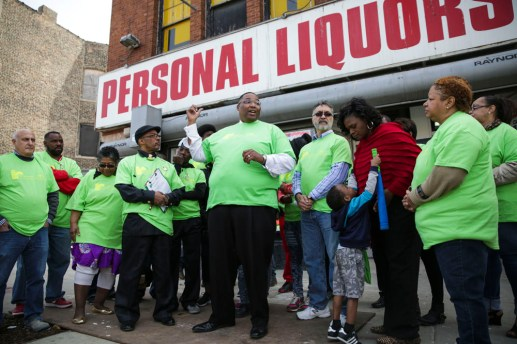 Ald. Jason Ervin (28th Ward) speaks against underage drinking, with member of West Garfield Community Stakeholders, outside Personal Liquors, on Saturday, April 18, 2015. The group says Personal Liquors, 4241 West Madison St, is a positive example of proper business practices. | CHANDLER WEST/Staff Photographer