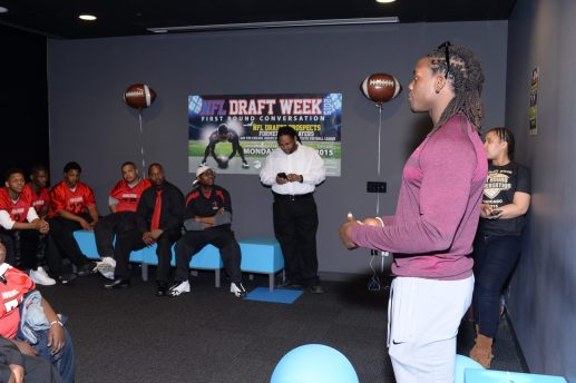 NFL Draft pick Melvin Gordon talks with players from the Chicago Jokers, a youth football team. Gordon, who was selected by the San Diego Chargers as the 15th pick, shared his story of growing up in Wisconsin as part of the NFL's First Round Conversations. (Photo by Bob Mead/Mead Communications)