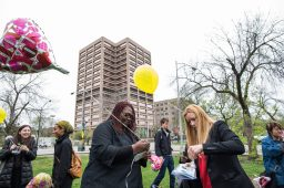 Josephine Horace-Jackson receives a balloon from Holly Krig to be released at the end of the vigil. | MAX HERMAN/Contributor