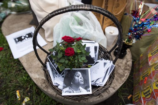 A basket with roses and cards, left, is set down during a vigil for mothers with incarcerated children held across from Cook County Jail. | MAX HERMAN/Contributor