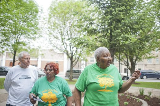 Austin Green Team president Mary Perry speak to the crowd on the morning of Saturday May 16, 2015, thanking those who came out to remember community leaders in the neighborhood of Austin in Chicago. (William Carmago/Staff Photographer)