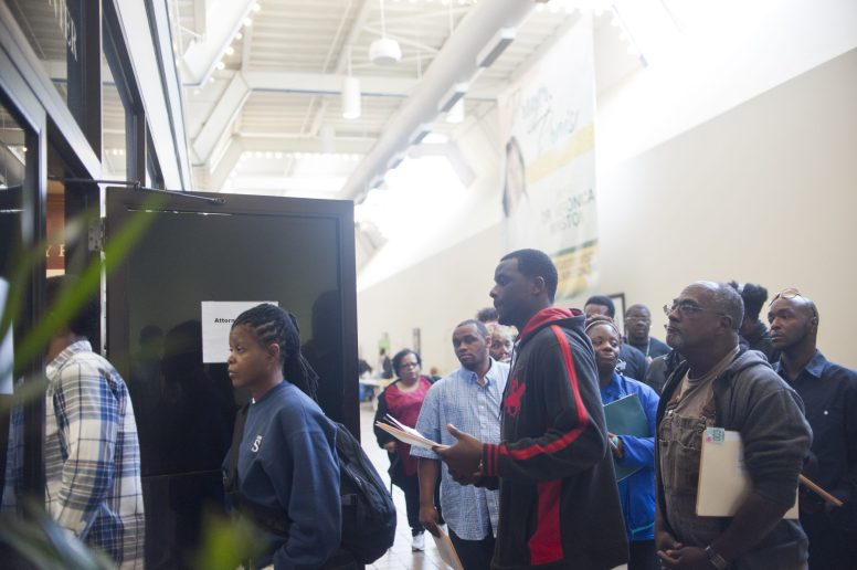 EXPUNGEMENT: Attendees at Clerk Dorothy Brown's Expungement Summit, held on June 6, file into a room to meet attorneys waiting to process applications that would expunge and seal criminal records. | WILLIAM CAMARGO/Staff Photographer