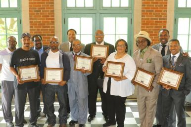 Recipients of the Leaders Network's first annual Black Fathers Standing Up and Making a Difference Award pose for a photograph with Leaders Network members. Submitted photo.
