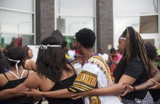 STATUE UNVEILING: Students who participated in the one year celebration of the naming of Mandela Road, performed traditional African dances on July 18, on the corner of Chicago Ave, and Cicero which is now known as Mandela Road. | WILLIAM CAMARGO/Staff Photographer