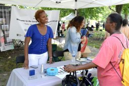 Kashanna Eiland sharing information with a visitor of the festival