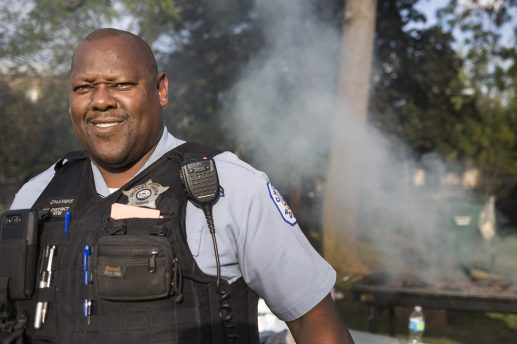 Officer Robert Chambis takes a break to pose for a photo during Night Out. | Alex Wroblewski/Contributor