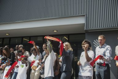 Community leaders cut the ribbon during the event. | WILLIAM CAMARGO/Staff Photographer