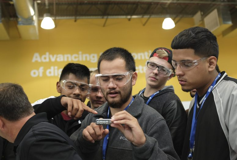 Jason Maldenado, a student at Prosser High School in Belmont Cragin, looks at a piece manufactured in Chicago with his classmates. On Friday, Oct. 2, 2015, CPS students from the South and West Sides toured the Digital Manufacturing and Design Innovation Institute on Goose Island in order to explore career possibilities in the field of manufacturing.