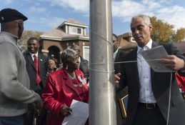 Lillian Drummond, left, looks on as Mayor Rahm Emanuel unties string from a street pole during a ceremony Thursday, Oct. 22, 2015, which designated a portion of Congress Pkwy. Honorary Lillian Drummond Pkwy. | William Camargo/Staff.