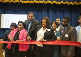 Staff and administrative members at Camelot Academy in West Garfield Park cut the ribbon during the alternative school's Oct. 28, 2015 open house. | William Camargo/Staff.