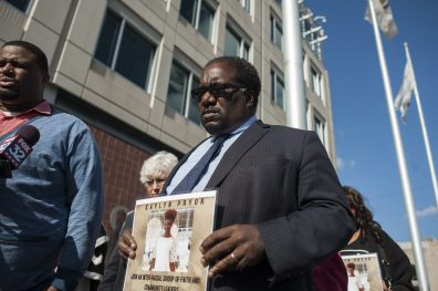 Rev. Marshall Hatch, Sr., holds up a sign of slain Evanston model Kaylyn Pryor, 20, who was killed Monday in Auburn Gresham. Hatch gathered with roughly a dozen other clergymen, many members of the Leaders Network, during a Nov. 5 press conference in front of Chicago police headquarters announcing the group's ,000 reward for information into Pryor's murder. | William Camargo/Staff