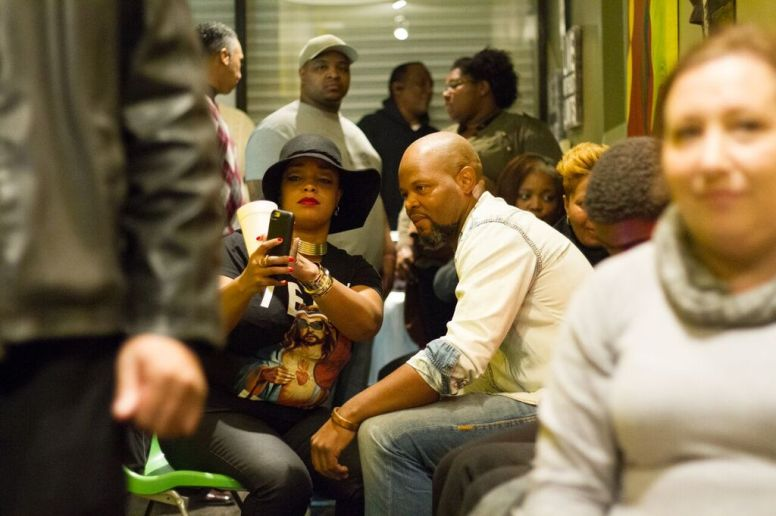 Quentin Love with supporters during a Dec. 15 watch party at his Turkey Chop Gourmet Grill, the West Side restaurant he owns. Love, who won the competition, donated his proceeds to the soup kitchen the restaurant operates. | Stacey Rupolo/Contributor.
